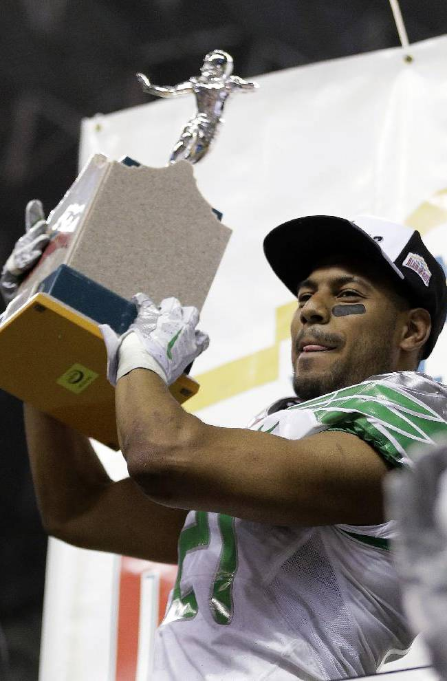 Oregon's Avery Patterson holds his trophy for Outstanding Defensive Player following the Valero Alamo Bowl NCAA college football game against Texas, Monday,  Dec. 30, 2013, in San Antonio. Oregon won 30-7