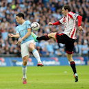 Sunderland's Adam Johnson, right, vies for the ball with Manchester City's Samir Nasri, during their English League Cup final soccer match at Wembley Stadium, London, England, Sunday, March 2, 2014