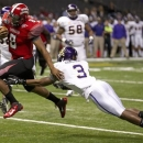 Louisiana-Lafayette quarterback Terrance Broadway (8) scores a touchdown as East Carolina defensive back Adonis Armstrong (3) defends in the first half of the New Orleans Bowl, an NCAA college football game in New Orleans, Saturday, Dec. 22, 2012. (AP Photo/Bill Haber)