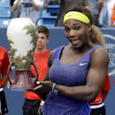 Serena Williams poses with the championship trophy after defeating Ana Ivanovic, from Serbia, 6-4, 6-1, in a final match at the Western & Southern Open tennis tournament, Sunday, Aug. 17, 2014, in Mason, Ohio. (AP Photo/Al Behrman)