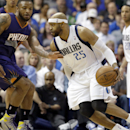 Dallas Mavericks guard Vince Carter (25) drives against Phoenix Suns forward P.J. Tucker (17) during the first half of an NBA basketball game on Saturday, April 12, 2014, in Dallas The Associated Press