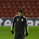 Real Madrid's James Rodriguez trains with teammates at Anfield Stadium, in Liverpool, England, Tuesday, Oct. 21, 2014. Real Madrid will play Liverpool in a Champion's League Group B soccer match on Wednesday