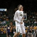 Baylor center Brittney Griner celebrates a break-away score by her team early in the first half of an NCAA college basketball game against West Virginia on Saturday, Jan. 19, 2013, in Waco, Texas. (AP Photo/Tony Gutierrez)