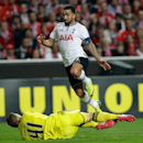 Tottenham Hotspur's Aaron Lennon, right, leaps over Benfica's goalkeeper Jan Oblak during their Europa League round of 16, second leg, soccer match Thursday, March 20 2014, at Benfica's Luz stadium
