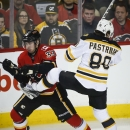 Brodie lifts Flames over Bruins 4-3 with 2 ticks left in OT The Associated Press