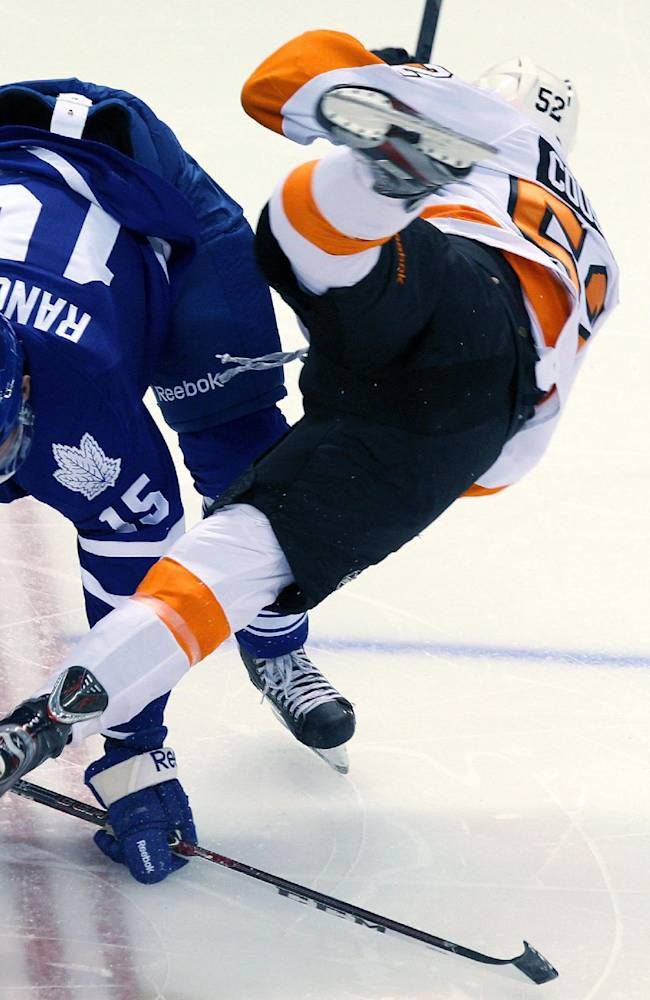 Toronto Maple Leafs' Paul Ranger, left, checks Philadelphia Flyers' Nick Cousins during first-period NHL hockey preseason game action on Sunday, Sept. 15, 2013, in London, Ontario