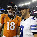Denver Broncos' Peyton Manning (18) and Dallas Cowboys' Tony Romo (9) smile as they talk at midfield following their NFL preseason football game, Thursday, Aug. 28. 2014, in Arlington, Texas. The Broncos won 27-3 The Associated Press