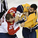 Nashville Predators defenseman Michael Liambas, right, fights with Florida Panthers right wing Shawn Thornton (22) in the third period of a preseason NHL hockey game Saturday, Sept. 27, 2014, in Nashville, Tenn. The Predators won 4-1. The Associated Press