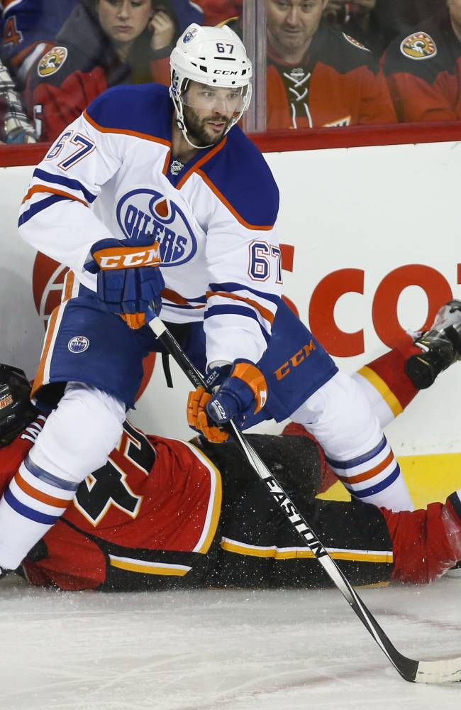 Flames rally in big third period to top Oilers 4-2