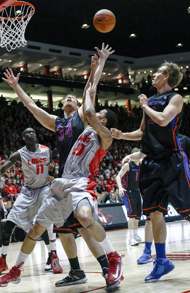 Boise State's Jake Ness (34) rebounds over New Mexico's Kendall Williams (10) during the first half of an NCAA college basketball game at The Pit in Albuquerque, N.M., Tuesday, Jan. 21, 2014