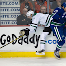 Vancouver Canucks' Shawn Matthias, right, checks Dallas Stars' John Klingberg, of Sweden, during the second period of an NHL hockey game Wednesday, Dec. 17, 2014, in Vancouver, British Columbia The Associated Press