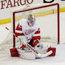 Detroit Red Wings goalie Jimmy Howard makes a save during the first period of an NHL hockey game against the Minnesota Wild, Saturday, March 22, 2014, in St. Paul, Minn. Howard made 28 saves in Detroit's 3-2 win The Associated Press
