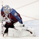 Colorado Avalanche goalie Semyon Varlamov, of Russia, makes a save on a prettily shot made by Winnipeg Jets center Jim Slater (19)during the first period of an NHL hockey game on Monday, March 10, 2014 in Denver The Associated Press