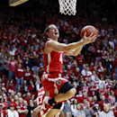 Ohio State guard Aaron Craft eyes the basket as he goes up to shoot the basketball in the first half of an NCAA basketball game against Indiana in Bloomington, Ind. Sunday, March 2, 2014 The Associated Press