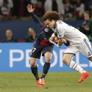 Chelsea's David Luiz, right, challenges PSG's Maxwell during the Champions League quarterfinal first leg soccer match between PSG and Chelsea, at the Parc des Princes stadium, in Paris, Wednesday, April 2, 2014