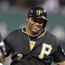 Pittsburgh Pirates' Marlon Byrd smiles as he rounds the bases after hitting a home run in the second inning of the NL wild-card playoff baseball game against the Cincinnati Reds on Tuesday, Oct. 1, 2013, in Pittsburgh The Associated Press