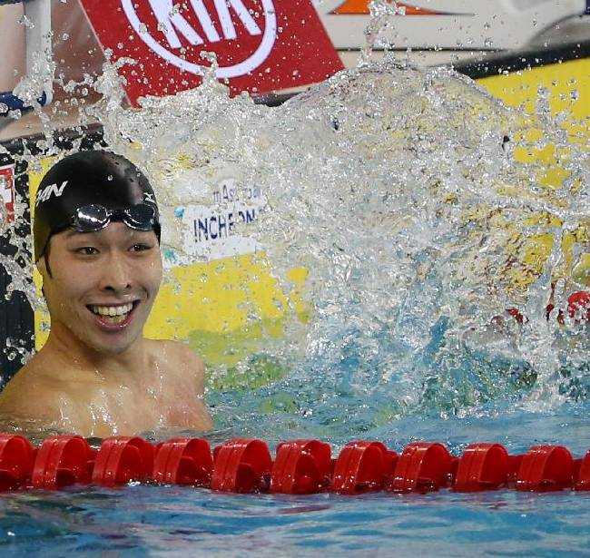 Japan's Kosuke Hagino celebrates after winning the men's 200-meter freestyle swimming final at the 17th Asian Games in Incheon, South Korea,  Sunday, Sept. 21, 2014