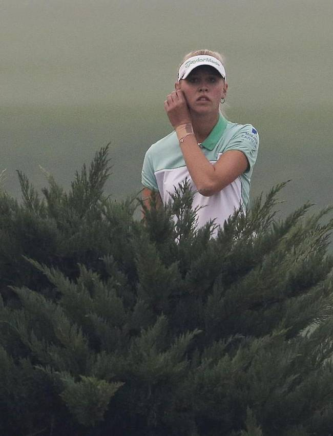 United States' Jessica Korda looks to see where her ball entered the water hazard on the 18th hole during the third round of the Reignwood LPGA Classic golf tournament at Pine Valley Golf Club on the outskirts of Beijing, China, Saturday, Oct. 5, 2013