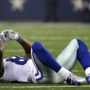 Dallas Cowboys wide receiver Dez Bryant is slow to get up after a play against the San Francisco 49ers in the first half of an NFL football game, Sunday, Sept. 7, 2014, in Arlington, Texas The Associated Press