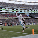 Miami Dolphins wide receiver Mike Wallace (11) catches a touchdown pass in front of New England Patriots defensive back Malcolm Butler, right rear, and safety Devin McCourty (32) in the first half of an NFL football game Sunday, Dec. 14, 2014, in Foxborou
