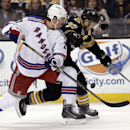 New York Rangers' Ryan McDonagh battles Boston Bruins' Patrice Bergeron (37) for the puck during the second period of Boston's 3-2 win in a NHL hockey game in Boston Friday, Nov. 29, 2013 The Associated Press