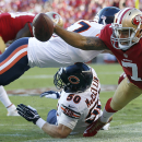 10ThingstoSeeSports - San Francisco 49ers quarterback Colin Kaepernick (7) is pushed out of bounds by Chicago Bears free safety Chris Conte, top, as Shea McClellin helps on defense during the first quarter of an NFL football game in Santa Clara, Calif., S