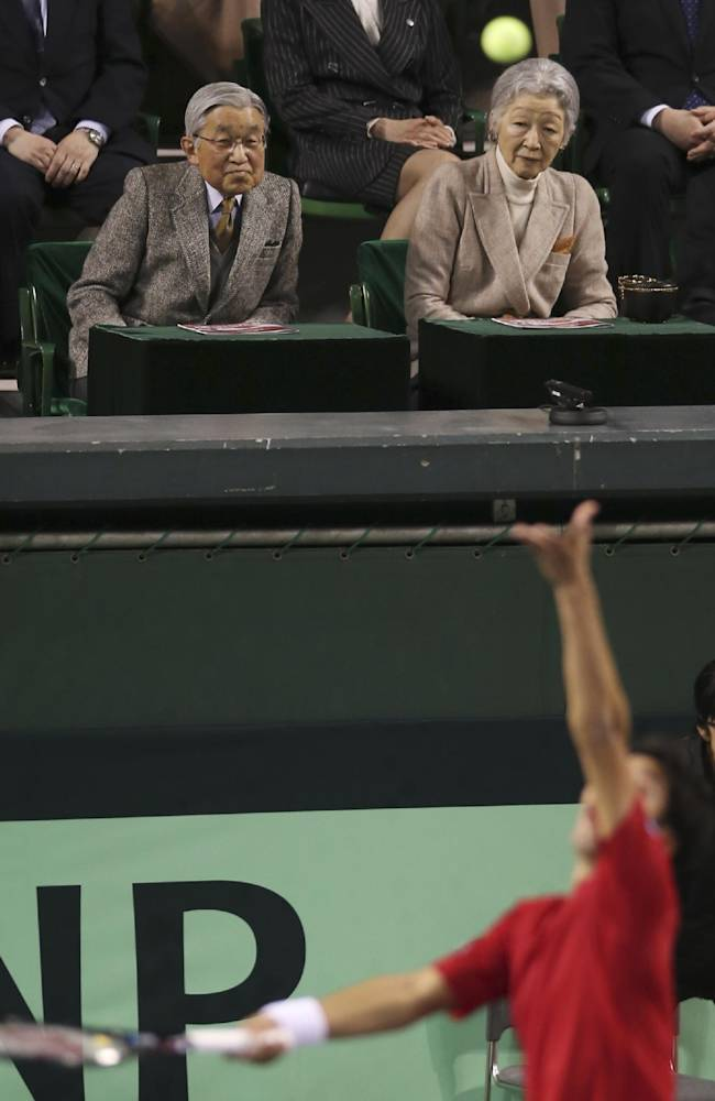 Japanese Emperor Akihito, top left, and Empress Michiko watch the game of Japan against Czech Republic during quarterfinals of Davis Cup World Group tennis at Ariake Colosseum in Tokyo, Saturday, April 5, 2014