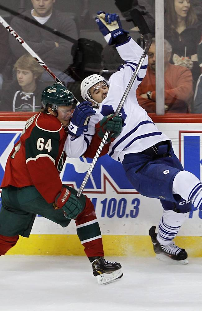 Toronto Maple Leafs center Nazem Kadri, right, and Minnesota Wild center Mikael Granlund (64), of Finland, tangle as they vie for the puck during the first period of an NHL hockey game in St. Paul, Minn., Wednesday, Nov. 13, 2013