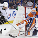 Los Angeles Kings Kyle Clifford (13) is stopped by Edmonton Oilers goalie Ben Scrivens (30) during first period NHL hockey action in Edmonton, Canada, Sunday March 9, 2014 The Associated Press