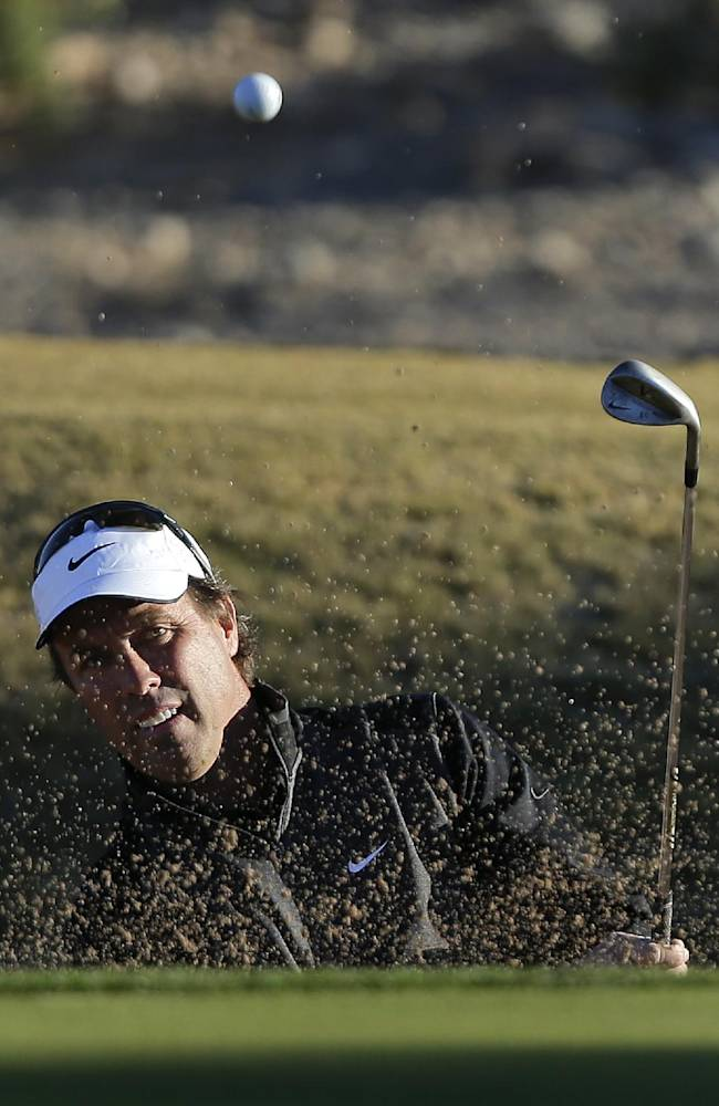 Stephen Ames, of Canada, hits out of a bunker onto the 14th green in the first round of the Shriners Hospitals for Children Open golf tournament, Thursday, Oct. 17, 2013, in Las Vegas