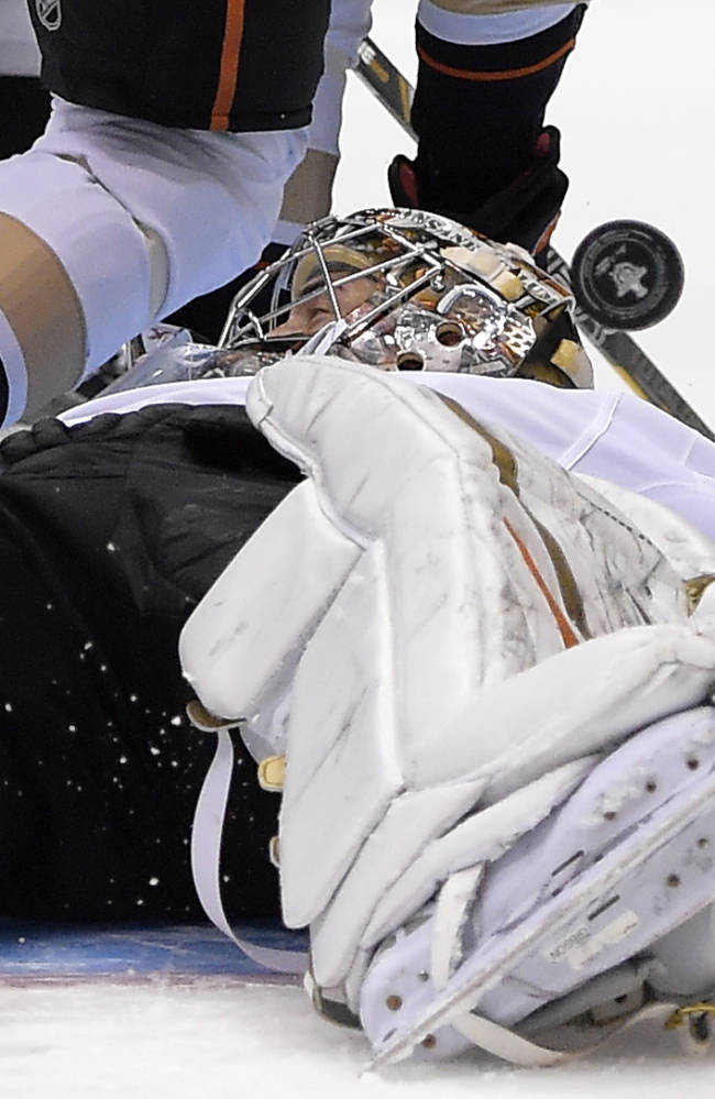 Anaheim Ducks goalie John Gibson stops a shot on goal during the second period in Game 4 of an NHL hockey second-round Stanley Cup playoff series against the Los Angeles Kings, Saturday, May 10, 2014, in Los Angeles