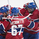 Montreal Canadiens' Max Pacioretty (67) celebrates with teammates Andrei Markov, left, and P.K Subban after scoring against the Toronto Maple Leafs during overtime of an NHL hockey game in Montreal, Saturday, March 1, 2014 The Associated Press