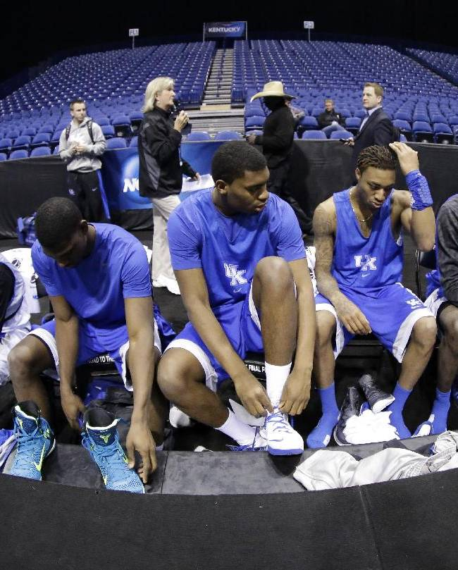 Kentucky players get ready for practice for their NCAA Midwest Regional semifinal college basketball tournament game Thursday, March 27, 2014, in Indianapolis. Tennessee plays Michigan on Friday, March 28, 2013