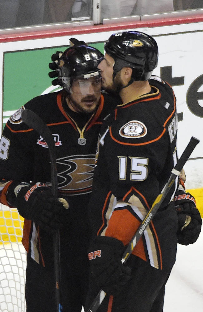 Anaheim Ducks right wing Teemu Selanne, of Finland,, left, gets a hug from center Ryan Getzlaf after they were defeated by the Los Angeles Kings in Game 7 of an NHL hockey second-round Stanley Cup playoff series, Friday, May 16, 2014, in Anaheim, Calif. The Kings won 6-2