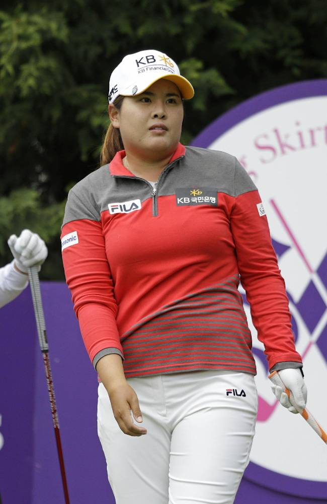 Inbee Park, right, of South Korea, follows her drive from the 13th tee of the Lake Merced Golf Club as Cristie Kerr, left, looks on during the first round of the Swinging Skirts LPGA Classic golf tournament Thursday, April 24, 2014, in Daly City, Calif