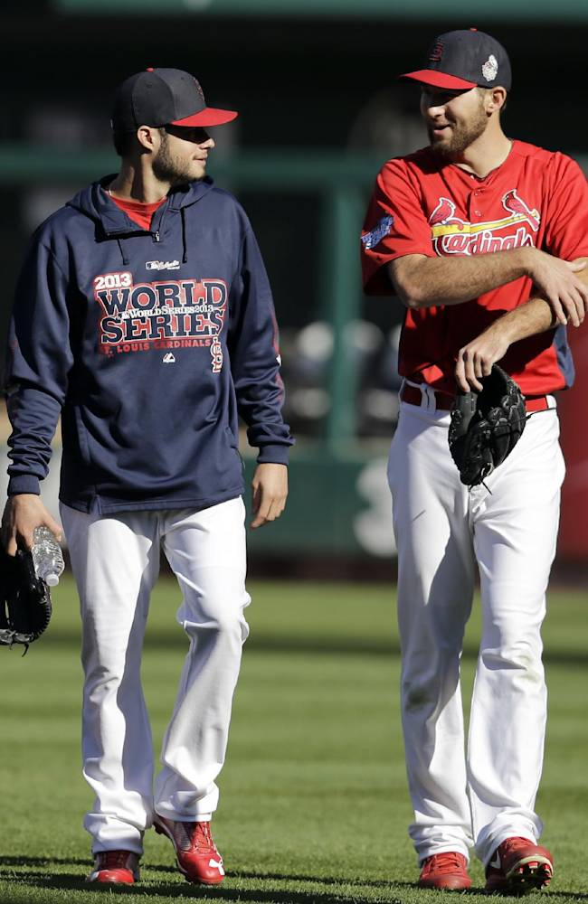 St. Louis Cardinals pitchers Joe Kelly, left, and Michael Wacha talk as they walk in from the bullpen Friday, Oct. 25, 2013, in St. Louis. The Cardinals and Boston Red Sox are set to play Game 3 of the World Series on Saturday in St. Louis