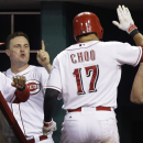 Cincinnati Reds' Shin-Soo Choo (17) is congratulated in the dugout by manager Dusty Baker, left, and Jay Bruce after Choo hit a solo home run off St. Louis Cardinals starting pitcher Lance Lynn in the fourth inning of a baseball game, Thursday, Sept. 5, 2013, in Cincinnati. (AP Photo/Al Behrman)