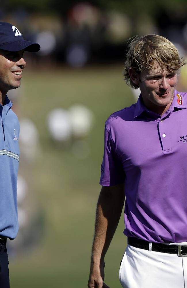 Matt Kuchar, left, walks off the 18th hole with Brandt Snedeker after they completed the second round of play in the Tour Championship golf tournament at East Lake Golf Club in Atlanta, Friday, Sept. 20, 2013
