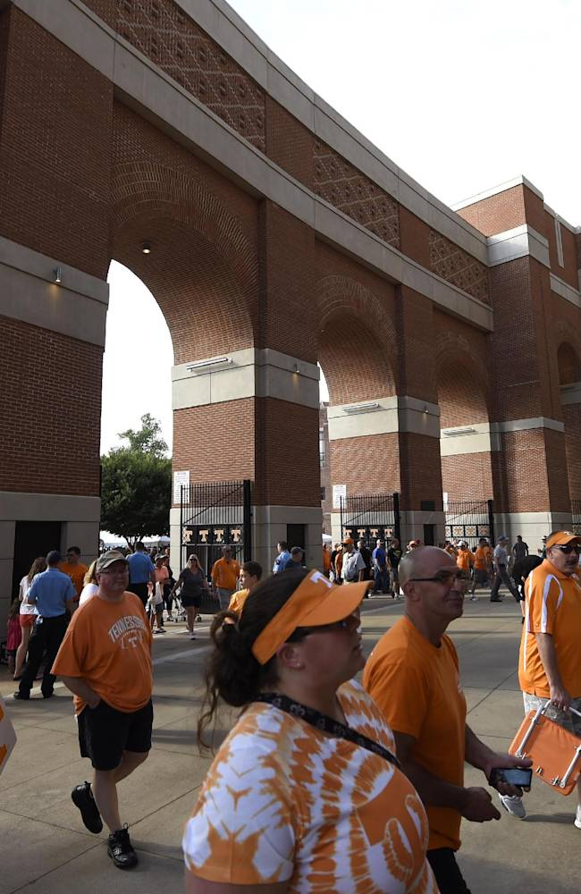 Tennessee fans flock inside Neyland Stadium for the football team's open NCAA college football practice in Knoxville, Tenn., on Saturday, Aug. 16, 2014