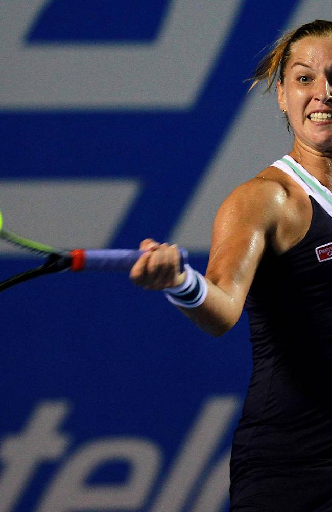 In this March 1, 2014 photo, Slovakia's Dominika Cibulkova returns the ball to Christina McHale of the U.S. during the final match of the Mexican Tennis Open in Acapulco, Mexico