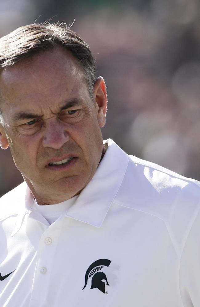 Michigan State coach Mark Dantonio watches his players before the Rose Bowl NCAA college football game against Stanford on Wednesday, Jan. 1, 2014, in Pasadena, Calif