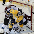 Nashville Predators forward Gabriel Bourque (57) tries to get a shot off in front of Colorado Avalanche defenseman Andre Benoit (61) and goalie Semyon Varlamov (1), of Russia, in the third period of an NHL hockey game on Tuesday, March 25, 2014, in Nashvi