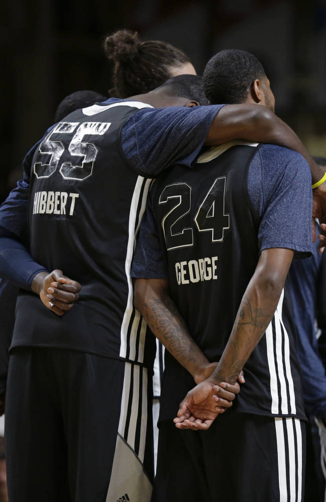 East Team's Roy Hibbert, of the Indiana Pacers, puts his arm around Paul George, of the Indiana Pacers, during NBA All-Star game basketball practice in New Orleans, Saturday, Feb. 15, 2014
