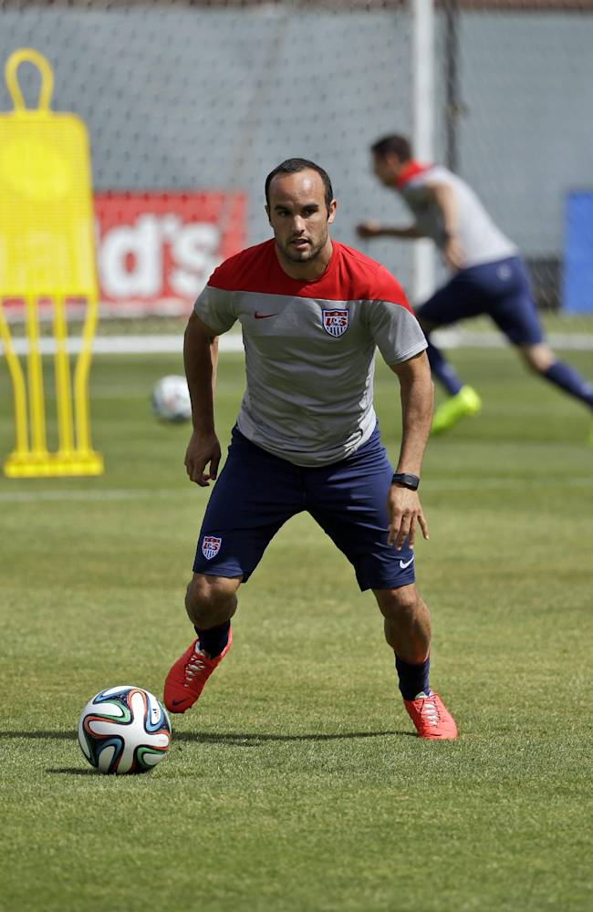 United States' Landon Donovan dribbles the ball during a training session in preparation for the World Cup soccer tournament on Friday, May 16, 2014, in Stanford, Calif
