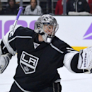 Los Angeles Kings goalie Jonathan Quick makes a glove save during the third period of an NHL hockey game against the Buffalo Sabres, Thursday, Oct. 23, 2014, in Los Angeles. The Kings won 2-0 The Associated Press