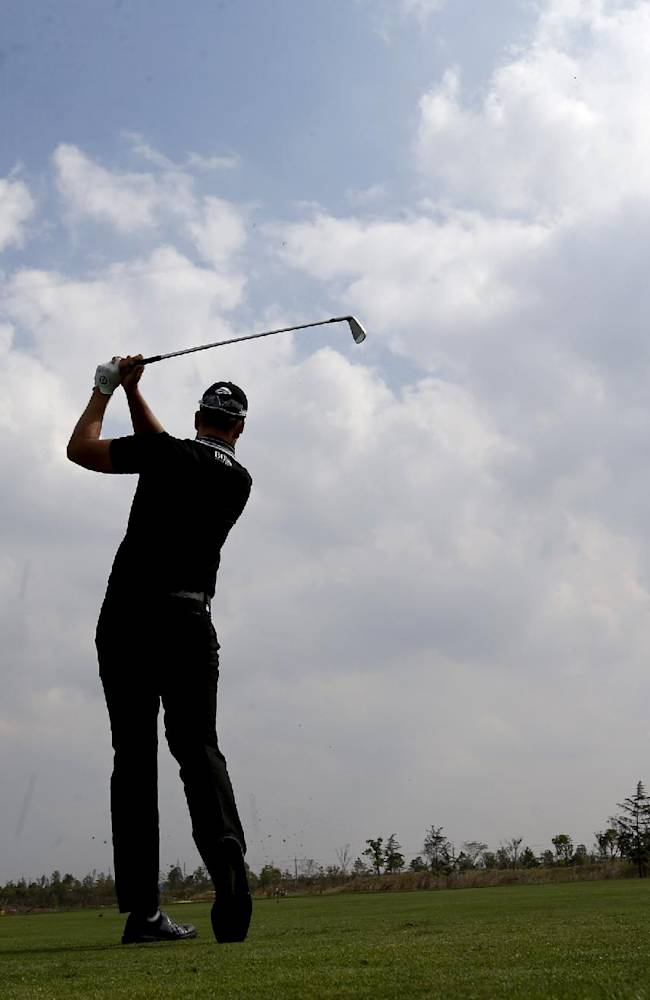 Henrik Stenson of Sweden tees off at the 2nd hole during a pro-am competition ahead of the BMW Masters golf tournament at the Lake Malaren Golf Club in Shanghai, China, Wednesday, Oct. 23, 2013. The European Tour event will begin on Oct. 24