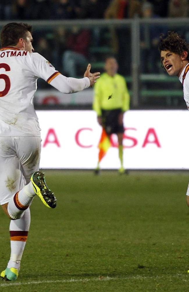 AS Roma's Kevin Strootman, left, of the Netherlands, celebrates with teammate Dodo' after scoring during a Serie A soccer match against Atalanta in Bergamo, Italy, Sunday, Dec. 1, 2013. The game ended 1-1 draw