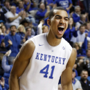 Kentucky's Trey Lyles celebrates after his dunk during the second half of an NCAA college basketball game against Buffalo, Sunday, Nov. 16, 2014, in Lexington, Ky. Kentucky won 71-52. (AP Photo/James Crisp)