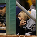 Milwaukee Brewers' Ryan Braun, right, and Rickie Weeks sit in the dugout during the ninth inning of a baseball game against the Pittsburgh Pirates in Pittsburgh, Thursday, April 17, 2014. The Pirates won 11-2 The Associated Press