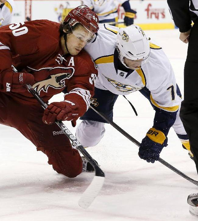 Phoenix Coyotes' Antoine Vermette (50) and Nashville Predators' Matt Cullen battle for the puck after a face off during the first period of an NHL hockey game on Thursday, Oct. 31, 2013, in Glendale, Ariz